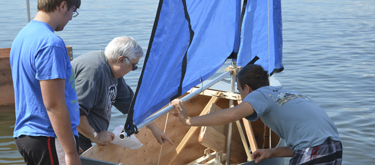 Students working on their boats on the Long Island Sound