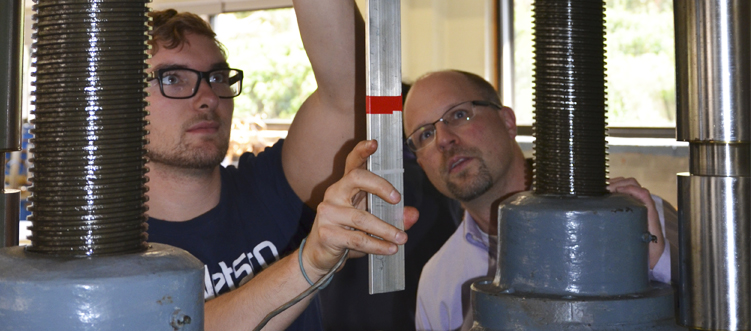 Student and Dean Werner conducting tensile testing in the Haeberle lab.