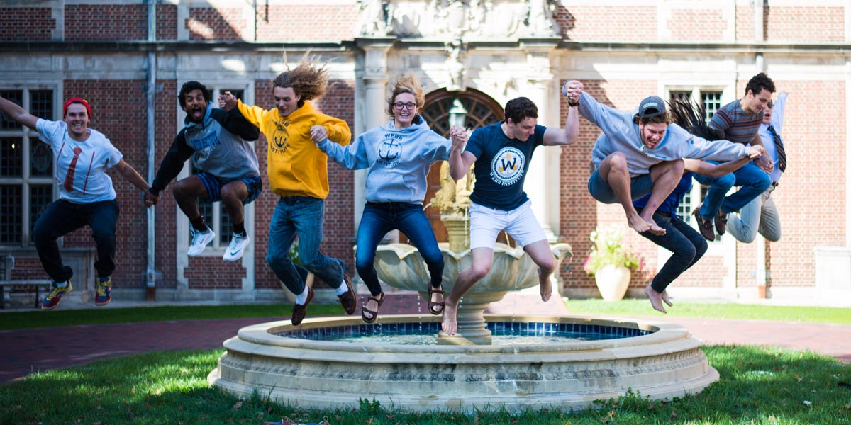 Students jumping in Cuneo Courtyard