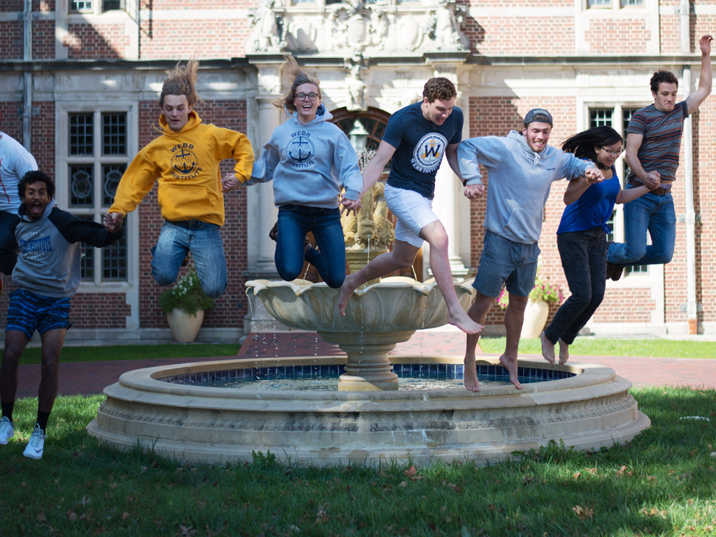 Students jumping off the fountain in Cuneo Courtyard