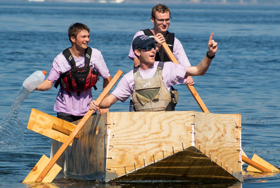 Students on their home-made boats during Family Weekend