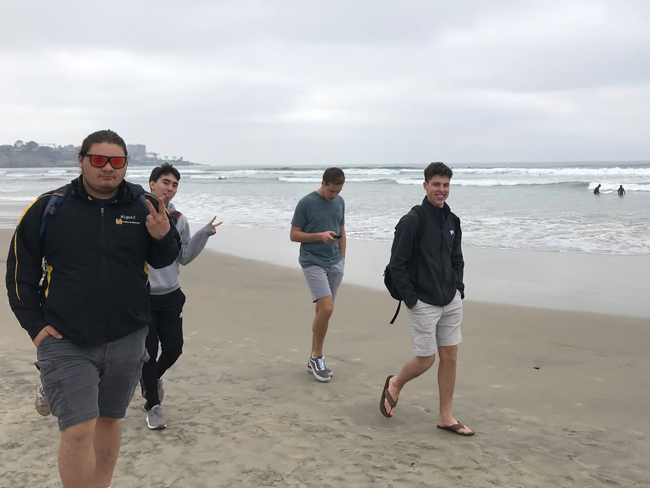 Students walking along the beachshore during Winter Work Term in San Diego